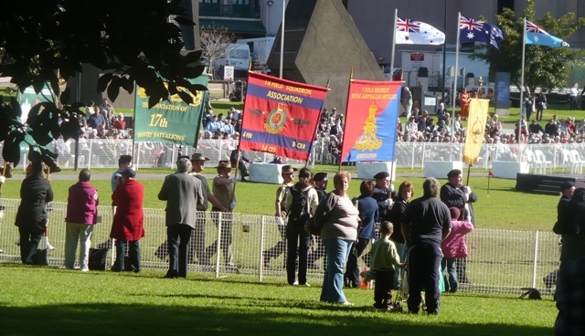 Association banners march on parade.
